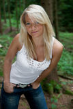 Young woman in a forest. Young attractive woman is posing in the forest Stock Images