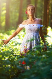 Young woman in forest Stock Photography