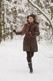 Young woman in the forest. Young woman is running in the winter forest Stock Image