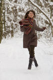 Young woman in the forest. Young woman is running in the winter forest Stock Images