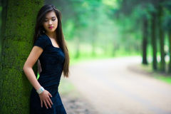 Young woman in forest. Shallow dof Stock Photo