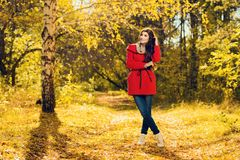 Young woman in forest. A full length portrait of a beautiful young woman in an autumn forest. Lifestyle, autumn fashion, beauty royalty free stock photos