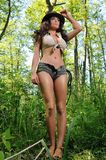 Young woman in the forest, like Indiana Jane Royalty Free Stock Image