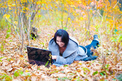 Young woman in the forest with notebook Royalty Free Stock Photo