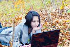 Young woman in the forest with notebook Royalty Free Stock Image