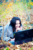 Young woman in the forest with notebook Royalty Free Stock Images