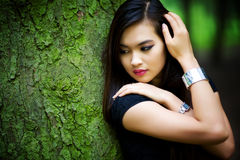 Young woman in forest portrait Stock Photos