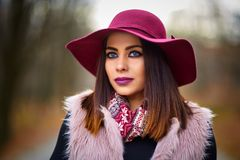 Young woman in the forest. Young woman with purple hat in the forest Stock Photos