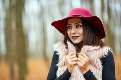Young woman in the forest. Young woman with purple hat in the forest Stock Photo