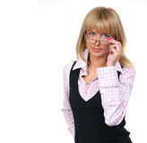 A young woman in a formal dress with glasses Royalty Free Stock Images