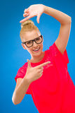 Young Woman Frames Her Face With Fingers. Royalty Free Stock Photo