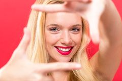 Young woman framing her face with her fingers Stock Photos