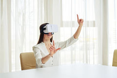 Young woman is framing something in virtual reality glasses Royalty Free Stock Photos