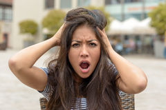 Young woman with a frantic expression royalty free stock photo