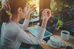Young woman freelance use laptop editing video footage in the coffee shop stock photo