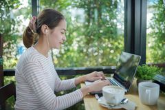 Young woman freelance use laptop stock images