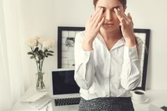 Young woman freelancer indoors home office concept formal style feeling unwell stock photo