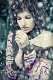 Young woman freeze. Under falling snow stock photo