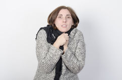 Young woman is freezing. Stock Photo