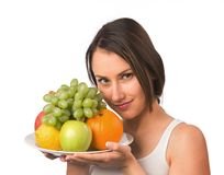 Young woman with fresh fruit Royalty Free Stock Photos