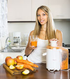 Young woman with fresh juice Royalty Free Stock Photography