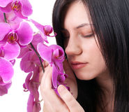 Young woman with fresh orchid Stock Photo
