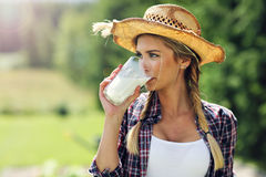 Young woman with fresh organic milk Stock Photography