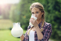 Young woman with fresh organic milk Stock Images