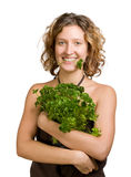 Young woman with fresh parsley Stock Photography