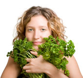 Young woman with fresh parsley Royalty Free Stock Images