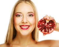 Young woman with fresh red pomegranate Stock Photos