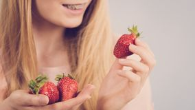 Young woman with fresh strawberries Royalty Free Stock Images