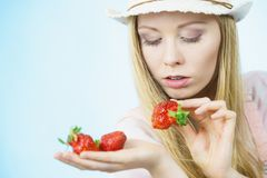 Young woman with fresh strawberries. Young woman eating fresh strawberries ts. Healthy meal Royalty Free Stock Photos