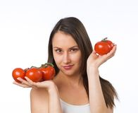 Young woman and fresh tomatoes Royalty Free Stock Images