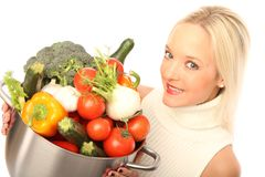 Young woman with fresh vegetables Royalty Free Stock Images