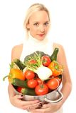 Young woman with fresh vegetables. Young blond woman holding some different fresh vegetables royalty free stock image