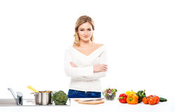 Young woman with fresh vegetables in the kitchen Stock Photos