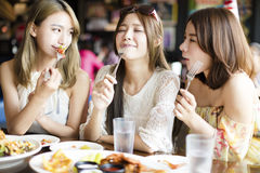 Young woman Friends Enjoying Meal in the Restaurant Royalty Free Stock Images
