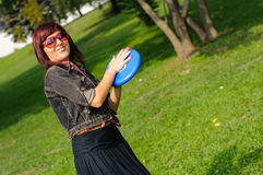 Young woman with frisbee Stock Image