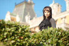 Young woman in front of  castle Stock Photography