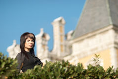 Young woman in front of  castle Stock Image