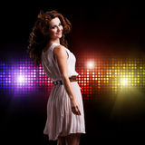 Young woman in front of a club background Royalty Free Stock Photo