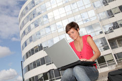 Young woman in front of college building Stock Photography