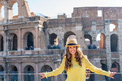 Young woman in front of colosseum in rome, italy Stock Photo