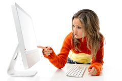Young woman in front of the computer stock photography