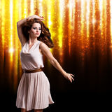 Young woman in front of a firework background Royalty Free Stock Images