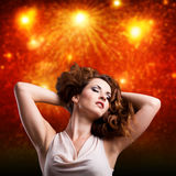 Young woman in front of a firework background Royalty Free Stock Photography