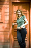 Young woman in front of her new vacation house Stock Photo