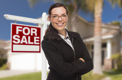Young Woman in Front of House and Sale Sign Royalty Free Stock Photos
