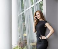 Young woman in front of office Royalty Free Stock Photo